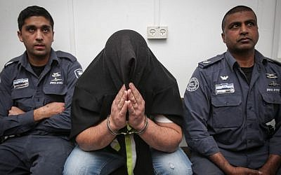 The male suspect of an arson attack in Pisgat Ze'ev is brought to the Jerusalem Magistrate's Court on February 2, 2015. (photo credit: Hadas Parush/Flash90)