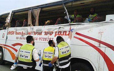 Emergency workers on site of a traffic accident that killed 8 and injured 20 in the south of Israel (photo credit: Shalom Ben Tzur/Zaka Spokesperson)