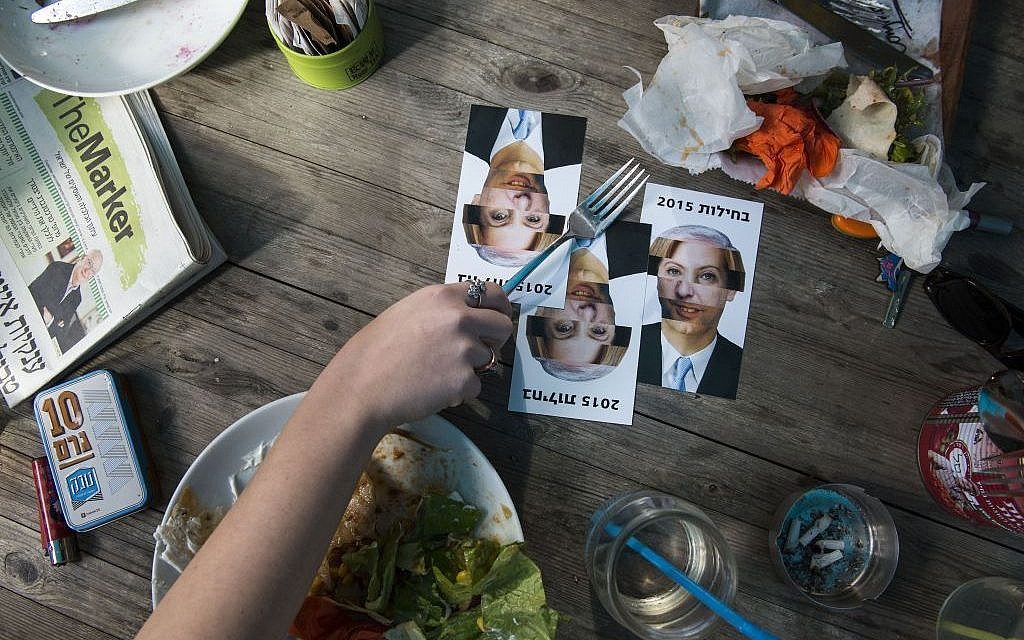 Postcards made by an Israeli artist reading 'Nausea 2015,' a play on the Hebrew word for 'elections,' and featuring composite portraits of the various party leaders, can be seen in Tel Aviv, February 5, 2015 (photo credit: Danielle Shitrit/FLASH90)