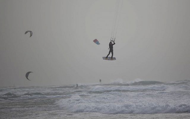 Illustrative photo of a windsurfer off the Tel Aviv shore on February 10, 2015 (Yonatan Sindel/ Flash90)