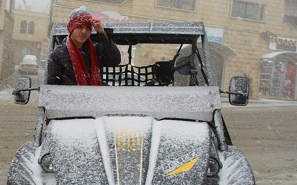 Snow falls in Majdal Shams, in the Golan Heights on February 11, 2015. (photo credit: Basal Awidat/Flash90)