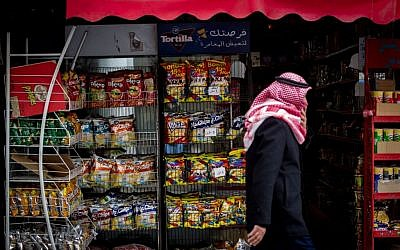 A Palestinian man walks by a store that stacks Israeli snacks in Bethlehem, on February 11, 2015. (photo credit: Miriam Alster/Flash 90)