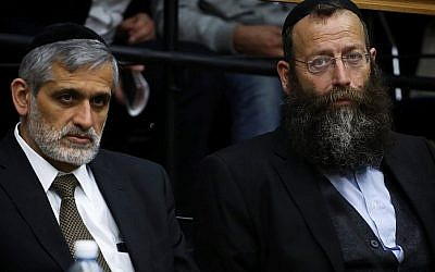 Yachad chairman Eli Yishai and extreme Right politician Baruch Marzel, seen during a discussion in the Central Elections Committee in the next Knesset, on February 12, 2015. (photo credit: Hadas Parush/FLASH90)