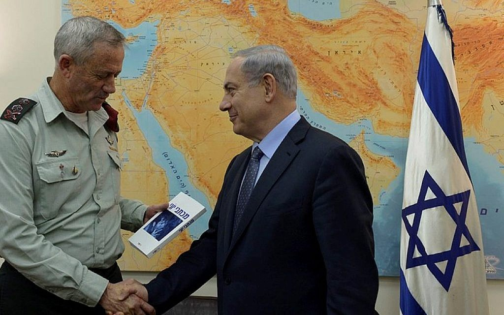 Prime Minister Benjamin Netanyahu meets with outgoing IDF Chief of Staff, Benny Gantz, at the military base, HaKirya, in Tel Aviv, February 12, 2015. (photo credit: Haim Zach / GPO)