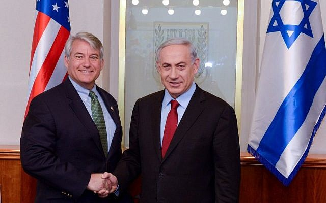 Prime Minister Benjamin Netanyahu (right) meets with US Rep. Dennis A. Ross (R-FL) at the Prime Minister's Office in Jerusalem on February 17, 2015. (photo credit: Haim Zach/GPO)