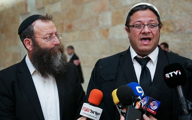 Right-wing politician Baruch Marzel (left) and attorney Itamar Ben Gvir speak to the press during the February 17, 2015 Supreme Court appeal of  a decision by the Central Election Committee to ban him and MK Hanin Zoabi from running for the Knesset in the upcoming elections. (Photo credit: Hadas Parush/FLASH90)