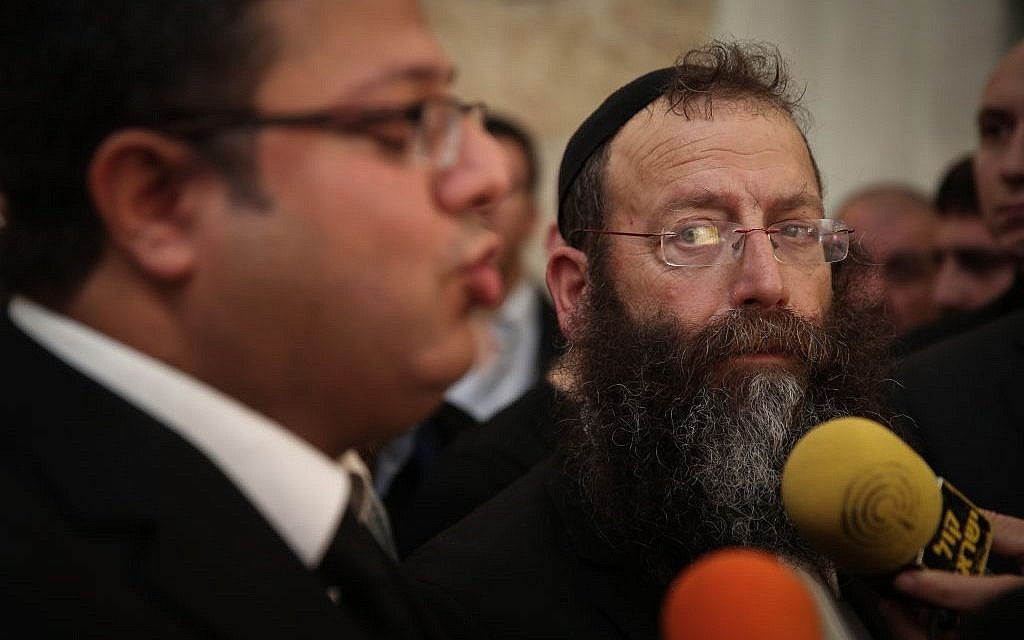 Baruch Marzel, with beard, speaking to the press with attorney Itamar ben Gvir at the Supreme Court in Jerusalem on February 17, 2015. (Photo credit: Hadas Parush/FLASH90)