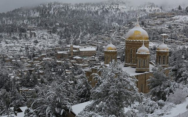The Church of Mary Magdalene, a Russian Orthodox church located on the Mount of Olives near the Garden of Gethsemane in Jerusalem, on a snowy day. February 20, 2015 (Nati Shohat/Flash90)