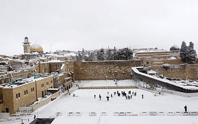 View of the Western Wall in the Old City of Jerusalem covered in snow, February 20, 2015. (photo credit: Yonatan Sindel/Flash90)