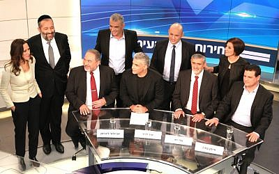 Foreign Minister and Yisrael Beytenu Chairman Avigdor Liberman (bottom L), Yair Lapid, leader of 'Yesh Atid' Party( bottom 2L), Leader of the Yachad party, Eli Yishai (bottom 2R), Leader of the combined Arab list, Ayman Odeh (bottom R), Meretz party leader Zahava Gal On (upper R), Leader of the ultra orthodox Shas party, Aryeh Deri (upper 2L), Leader of Habayit Hayehudi (Jewish Home) party, Naftali Bennett (upper 2R) and Leader of the Kulanu party Moshe Kahlon (upper C) and Channel 2 TV news anchorman, Yonit Levi (upper L) seen before a Channel 2 news political debate ahead of the 2015 Israeli election. in the Neve Ilan studios near Jerusalem on February 26, 2015. (Photo cedit: Channel 2 News)