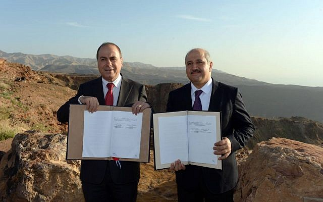 "Energy and Water Minister Silvan Shalom (L) and his Jordanian counterpart Hazem Nasser seen during a signing ceremony between Jordan and Israel in Jordan on February 26, 2015, Israel and Jordan sign Tuesday the ""Red-Dead"" agreement to jointly build a desalination plant north of the Jordanian tourist resort of Akaba.  (Photo credit: Haim Zach/GPO)"