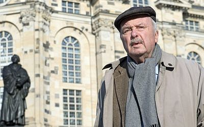 Eberhard Renner stands in front of the Frauenkirche cathedral (Church of Our Lady) during an interview one day before the 70th anniversary of the deadly Allied bombing of the city during World War II, February 12, 2015 (Photo credit: Jens Meyer/AP)