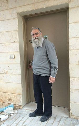 Netzer-Ariel Rabbi Zion Tawil outside his newly built house in Ariel. (photo credit: Renee Ghert-Zand/Times of Israel)