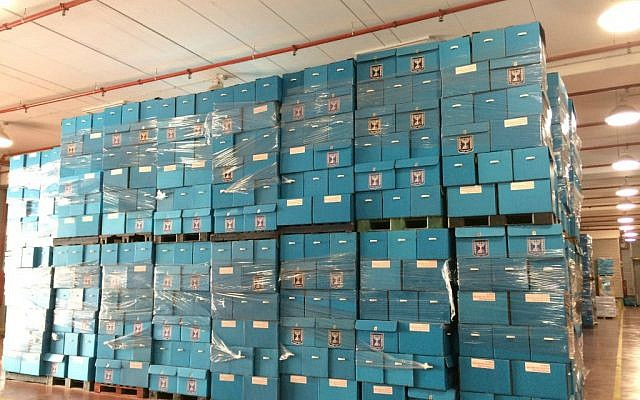 Ballot boxes are stacked floor to ceiling at Central Elections Committee's logistics center, February 24, 2015. (photo credit: Renee Ghert-Zand/TOI)