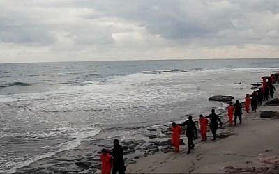 This image made from a video released Sunday Feb. 15, 2015 by militants in Libya claiming loyalty to the Islamic State group purportedly shows Egyptian Coptic Christians in orange jumpsuits being led along a beach, each accompanied by a masked militant before the men are simultaneously beheaded. (AP Photo)