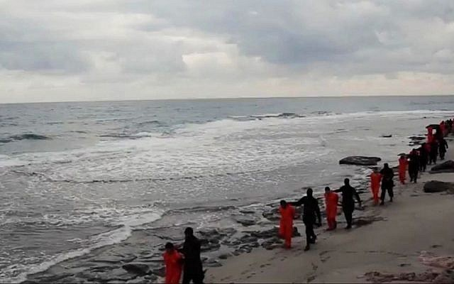This image made from a video released February 15, 2015, by militants in Libya claiming loyalty to the Islamic State group purportedly shows Egyptian Coptic Christians in orange jumpsuits being led along a beach, each accompanied by a masked militant before the men are simultaneously beheaded. (AP Photo)