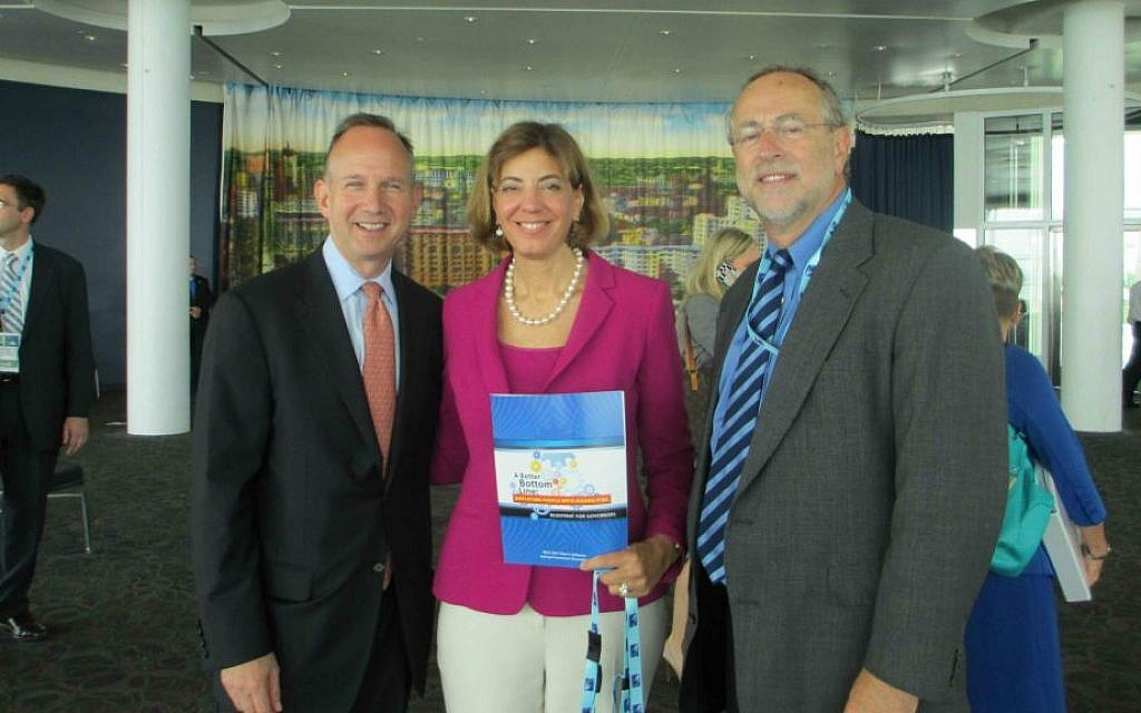Jennifer Laszlo Mizrahi is flanked by Delaware Gov. Jack Markell, left, and RespectAbility board member Doc Sweitzer at the 2013 launch of A Better Bottom Line, a National Governors Association guide for employing people with disabilities. (Courtesy of RespectAbility/JTA)