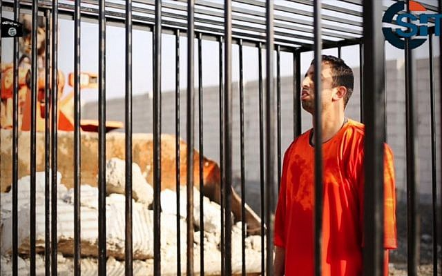 This still image made from a video released by Islamic State group militants and posted on the website of the SITE Intelligence Group on February 3, 2015, purportedly shows Jordanian pilot Lt. Mu'ath al-Kaseasbeh standing in a cage just before being burned to death by his captors. (photo credit: AP/SITE Intelligence Group)