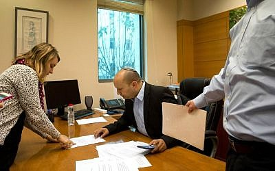 Economy Minister Naftali Bennett, leader of the Jewish Home party, works in his office before an interview to The Associated Press in Jerusalem, Monday, February. 16, 2015. (AP/Tsafrir Abayov)