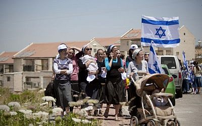 In this June 4, 2012 file photo, Jewish settlers march during a demonstration against the proposed decision to evacuate a West Bank outpost in the Ulpana neighborhood, in the West Bank settlement of Beit El. (photo credit: AP/Ariel Schalit, File)