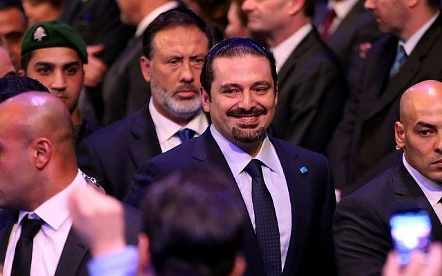 Former Lebanese prime minister Saad Hariri (center), escorted by his bodyguards, arrives at a ceremony to mark the 10th anniversary of the assassination of his father, former prime minister Rafik Hariri, Beirut, Lebanon, February 14, 2015. (photo credit: AP/Hussein Malla)