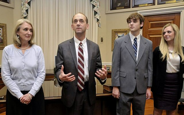 In this Jan. 12, 2015 photo, Tom Schweich, second from left, in his Capitol office in Jefferson City. photo credit: AP Photo/News Tribune, Julie Smith)