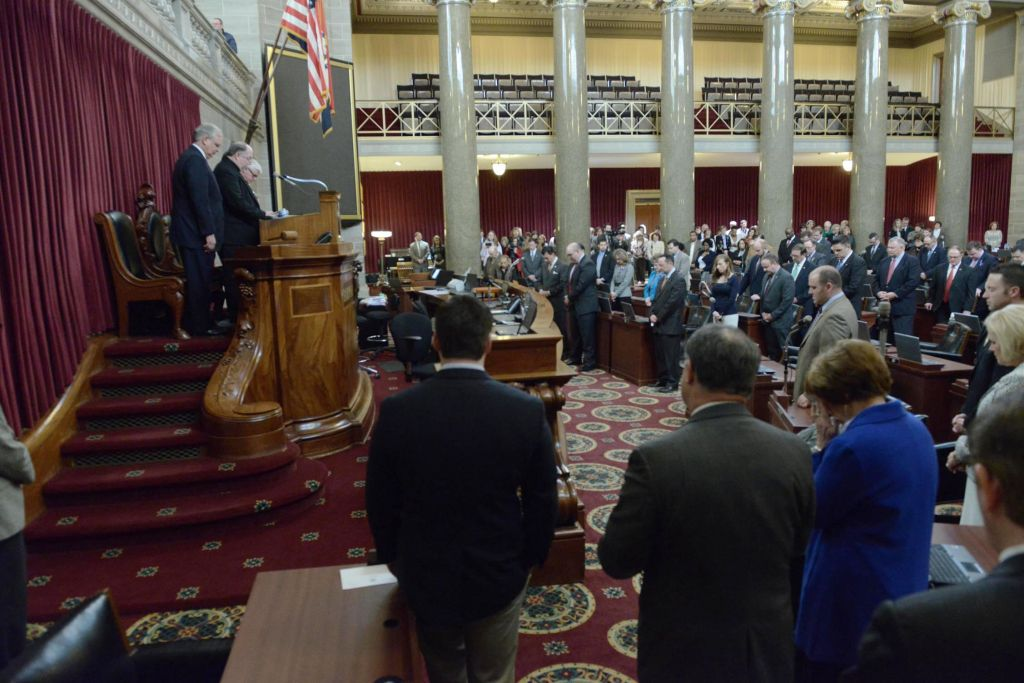 In this photo provided by Tim Brommel, Missouri Gov. Jay Nixon, at left, bows his head with Monsignor Robert Kurwicki; Speaker John Diehl and Lt. Gov. Peter Kinder as Senators and Representatives join for a brief prayer service for the family of Missouri Auditor, Tom Schweich Thursday, Feb. 26, 2015 in the House Chamber in Jefferson City, Mo. Schweich, a Republican candidate for governor, died Thursday of a self-inflicted gunshot wound, a staff member told The Associated Press. (photo credit: AP Photo/Missouri House of Representatives, Tim Bommel)