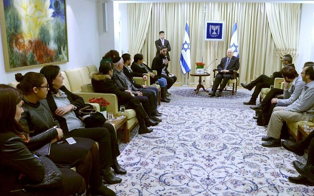President Reuven Rivlin meets with members of the Cohen, Braham and Saada families, whose loved ones were murdered in a terror attack on a kosher supermarket in Paris last month, on February 9, 2015. (photo credit: Mark Neyman/GPO)