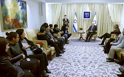 President Reuven Rivlin meets with the families of the victims of last month's terror attack at a kosher supermarket, in Paris, February 9, 2015. (Photo credit: Mark Neyman/GPO)