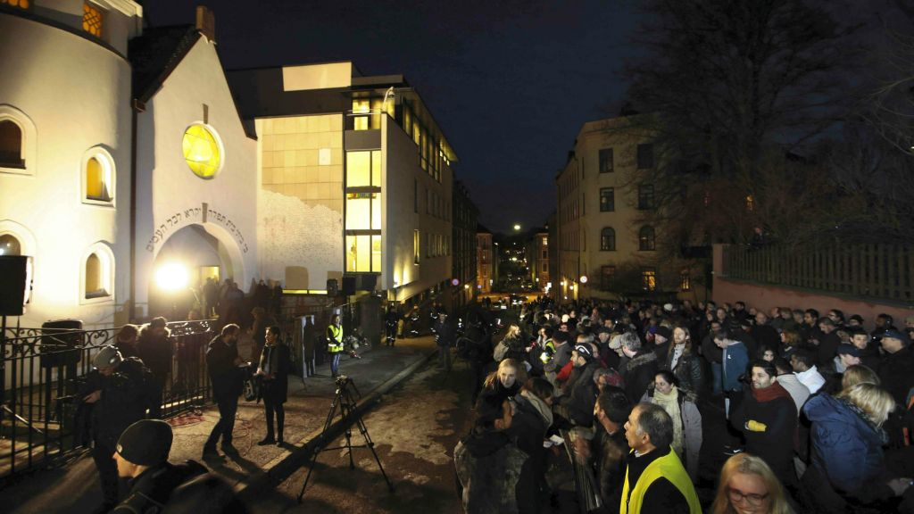"More than 1,000 people formed a ""ring of peace"" around the Norwegian capital's synagogue, an initiative taken by young Muslims in Norway after a series of attacks against Jews in Europe, in Oslo, Saturday, February 21 2015. (photo credit: AP/Hakon Mosvold Larsen/NTB Scanpix)"