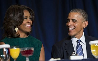 President Barack Obama and First Lady Michelle Obama at the National Prayer Breakfast in Washington, Thursday, Feb. 5, 2015. (AP Photo/Evan Vucci)