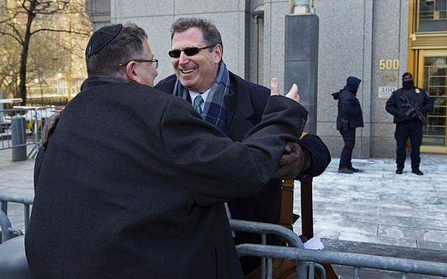 Attorney Kent Yalowitz, right, representing those affected by attacks in Israel in the early 2000s, hugs Mark Weiss of New York outside a federal courthouse in New York Monday, Feb. 23, 2015. The court found the Palestinian authorities liable in the attacks, with jurors awarding the victims $218.5 million in damages at a civil trial. (photo credit: AP Photo/Craig Ruttle)