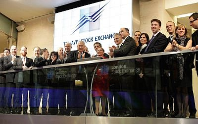 Ester Levanon, former CEO of the Tel Aviv Stock Exchange (TASE) together with CEO of the London Stock Exchange (LSE) Group, Xavier Rolet, along with Israeli and British officials, open trading on the London Stock Exchange June 12, 2013 (Photo credit: London Stock Exchange)