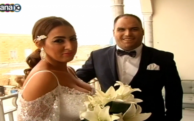 Daniel Fahima, a victim of the Burgas bombing, and Dana Levy, the woman who helped him recuperate, got hitched. (screen capture: Channel 10)