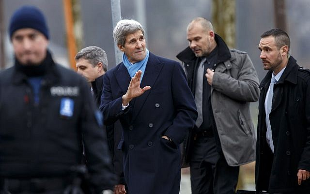 U.S. Secretary of State John Kerry, center, returns to his hotel after walking on the bank of Lake Geneva, following a bilateral meeting with Iranian Foreign Minister Mohammad Javad Zarif in Geneva, Switzerland, Monday, Feb. 23, 2015. (photo credit: AP Photo/Keystone, Salvatore Di Nolfi)