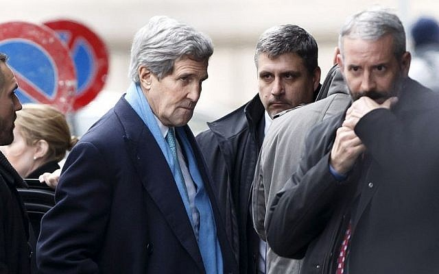 US Secretary of State John Kerry, center, arrives at the hotel prior to a bilateral meeting with Iranian Foreign Minister Mohammad Javad Zarif for a new round of Nuclear Talks, in Geneva, Switzerland, Sunday, Feb. 22, 2015. (photo credit: AP/Keystone,Salvatore Di Nolfi)