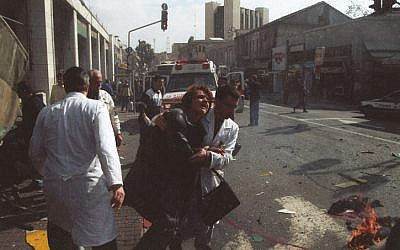 A woman is evacuated for medical treatment after a female suicide bomber blew herself up in the center of Jerusalem, January 27, 2002. (Flash90)