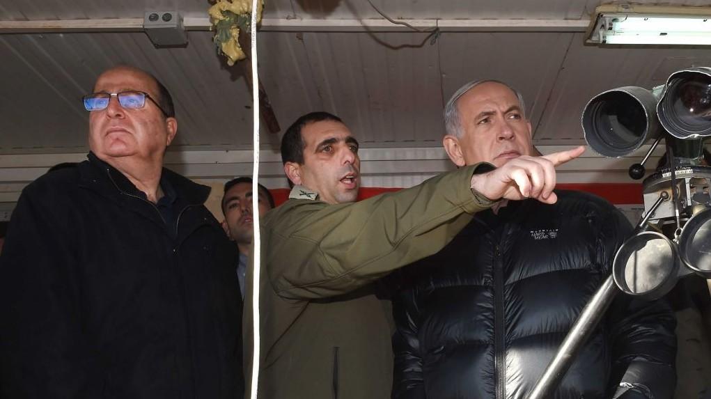 Israeli Prime Minister Benjamin Netanyahu and Defense Minister Moshe Ya'alon seen at Mount Hermon, overlooking the Israeli border with Syria. February 04, 2015. (photo credit: Effi Sharir/POO)