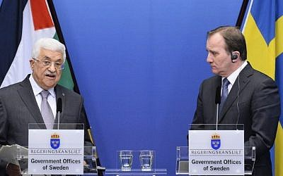 Prime Minister of Sweden Stefan Loefven (R) and Palestinian president Mahmoud Abbas hold a joint press conference in Stockholm on February 10, 2015. (Photo credit: AFP photo/Jonathan Nackstrand)