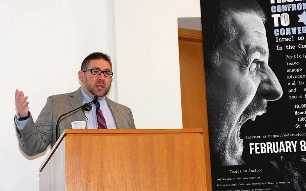 Mideast historian Asaf Romirowsky speaks on anti-Semitism at an event. His essay, 'In Intent, If Not in Effect: The Failure of BDS,' is featured in the new book, 'The Case Against Academic Boycotts of Israel' (photo: Jewish Community Relations Council of Minnesota and the Dakotas)
