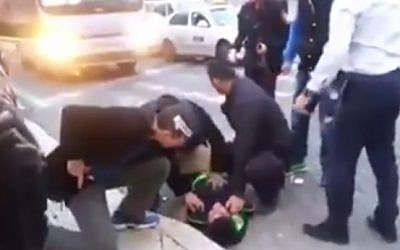A Palestinian stabber is taken down by security guards in Jerusalem after attacking a 27-year-old Israeli man (photo credit: Screen capture)