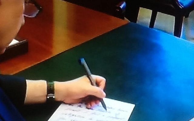 Benjamin Netanyahu writing text for his March 3 speech to Congress, in a clip released by the PMO on February 28 (Channel 2 screenshot)