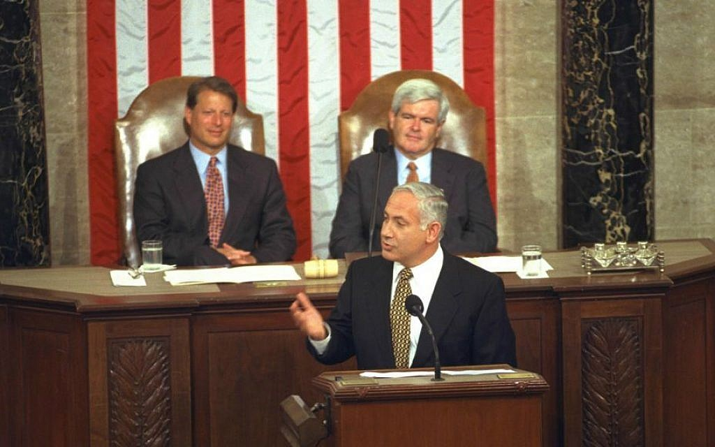 Prime Minister Benjamin Netanyahu addressing a joint meeting of the US Congress, July 10, 1996. Seated behind him are US vice president Al Gore, left, and House Speaker Newt Gingrich. (photo credit: Yaacov Saar/GPO)