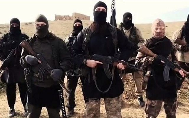 Screen capture from an earlier video released by French-speaking Islamic State members that may show fugitive terror suspect Hayat Boumeddiene (front row Right) who is wanted in France. (screen capture: YouTube/24/7 News online)