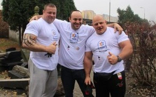 Jonny Daniels, center, with Polish Strongman Federation members in 2014. (Photo credit: courtesy of From the Depths via JTA)