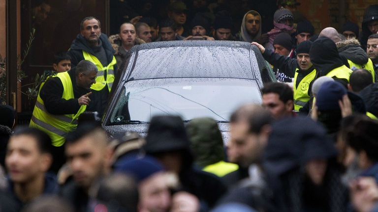 Mourners surround the hearse with late Omar Abdel Hamid El-Hussein in Copenhagen, on February 20 2015. (AFP/Scanpix Denmark/Nils Meilvang)