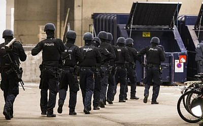 Police forces patrol in a street near the Norrebro Station where the alleged author of two fatal attacks opened fire in the Danish capital before being shot in a police action at another place in Copenhagen on February 15, 2015. (photo credit: AFP/Scanpix Denmark/ Martin Sylvest)