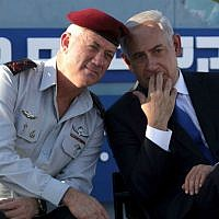 Then IDF Chief of Staff Lt. Gen. Benny Gantz (left) with Prime Minister Benjamin Netanyahu at a Navy ceremony on September 11, 2013. (AP Photo: Dan Balilty)