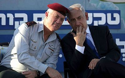Then IDF Chief of Staff Lt. Gen. Benny Gantz with Prime Minister Benjamin Netanyahu at a Navy ceremony on September 11, 2013. (AP Photo: Dan Balilty)