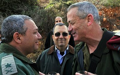 Then-IDF chief Gantz, then-defense minister Ehud Barak, and Maj. Gen. Gadi Eisenkot during a February 15, 2011, tour of the northern border (Ministry of Defense/ Flash 90)